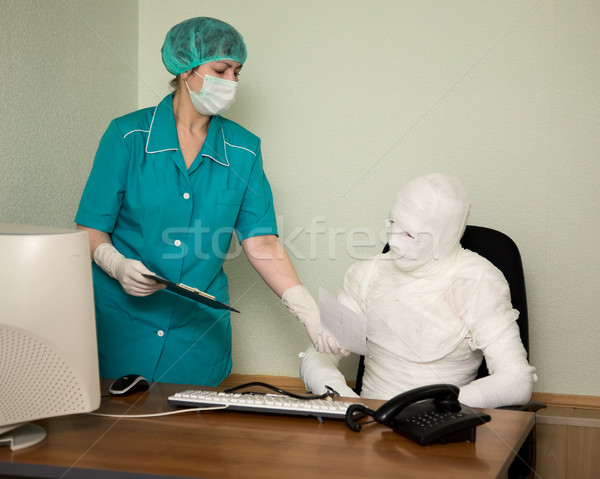 Stock photo: Patient similar to a mummy and the doctor