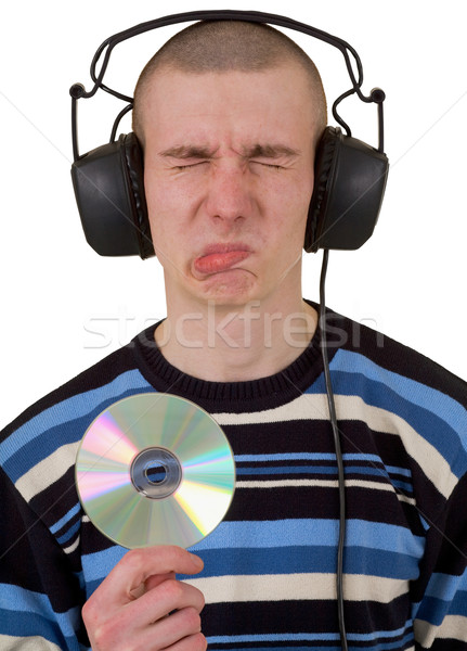 Man in phones and compact disk Stock photo © pzaxe