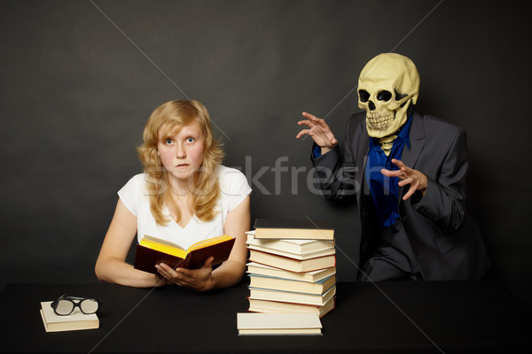 Woman reading a terrible book in dark Stock photo © pzaxe
