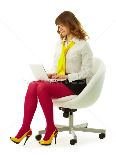 Girl in a bright dress with a laptop Stock photo © pzaxe