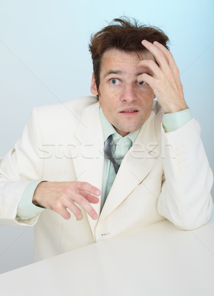 Young amusing tousled scared person in white jacket Stock photo © pzaxe