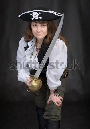 Girl - pirate with sabre and pistol on a black Stock photo © pzaxe