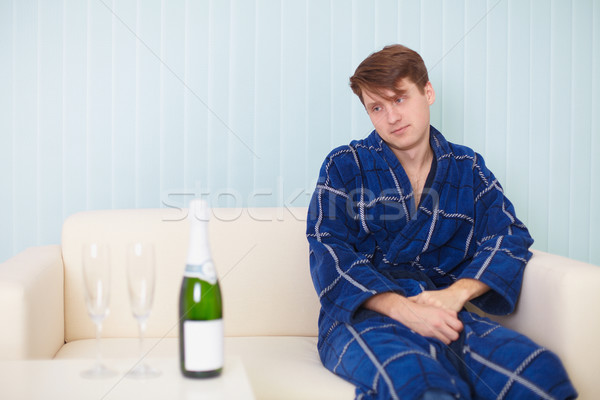 person in expectation of woman with sparkling wine on sofa Stock photo © pzaxe