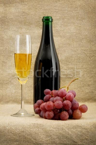Champagne bottle, goblet, grapes Stock photo © pzaxe