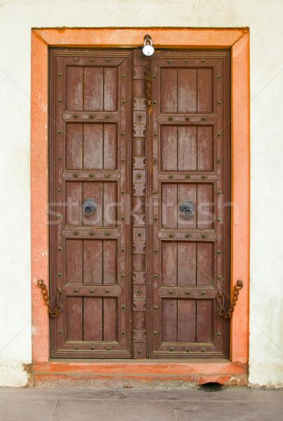 Old wooden door on a building facade. India, Agra Stock photo © pzaxe