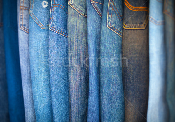 Blue-Jeans in Various Shades of Blue, Arranged on Display. Stock photo © pzaxe