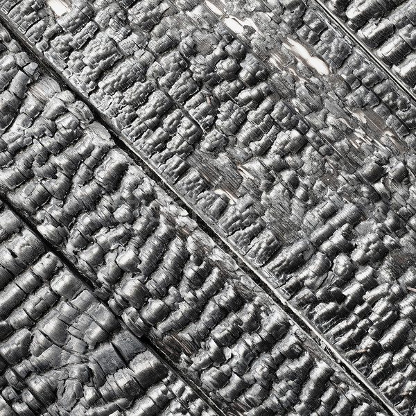 Wooden wall blackened after fire - texture Stock photo © pzaxe