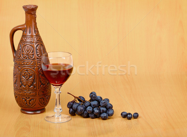 Artistic composition - crock, glass and grapes Stock photo © pzaxe