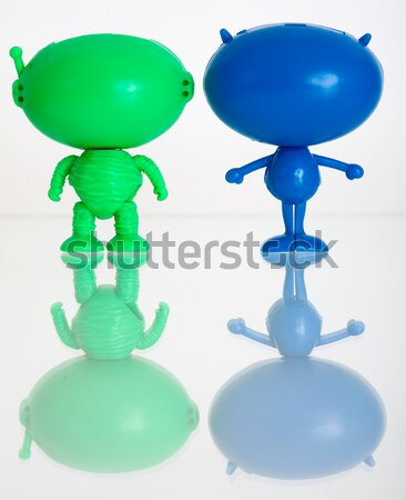 Two plastic aliens on a stairs from dominoes Stock photo © pzaxe