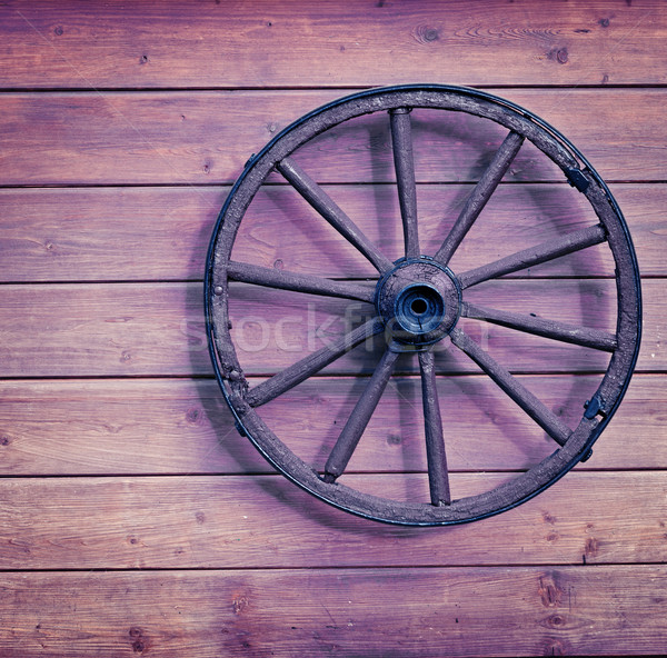 Vintage wooden wheel on wall Stock photo © pzaxe