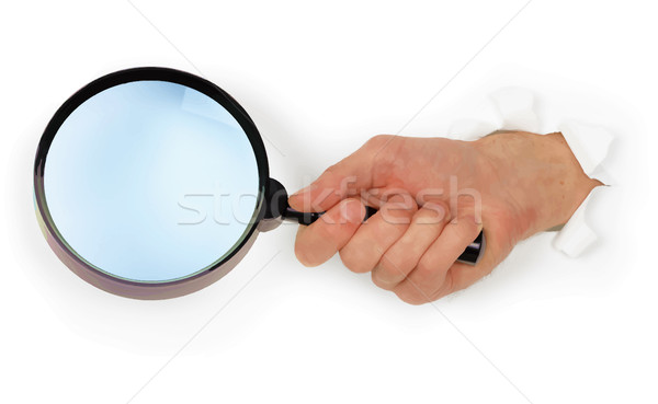 Vector hand holding simple magnifying glass on white paper backg Stock photo © pzaxe