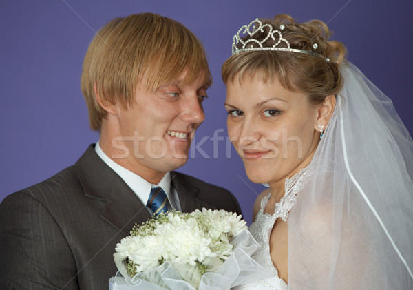 Bride and groom on purple background Stock photo © pzaxe