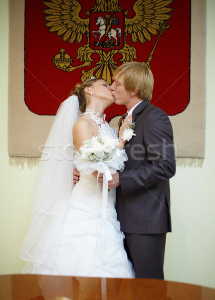 Newly married kiss under Russian arms Stock photo © pzaxe