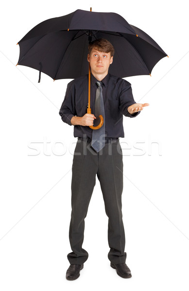 Person protected by a large umbrella Stock photo © pzaxe