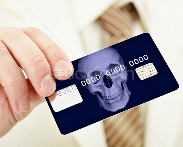 Banking plastic credit card bearing death Stock photo © pzaxe