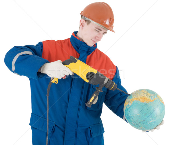 Builder, terrestrial globe and perforator Stock photo © pzaxe