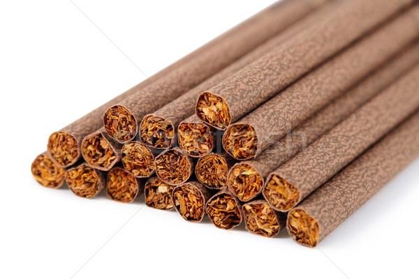 Brown ladies cigarette on white background Stock photo © pzaxe