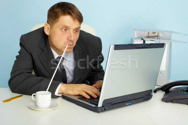 a very busy man working with laptop Stock photo © pzaxe