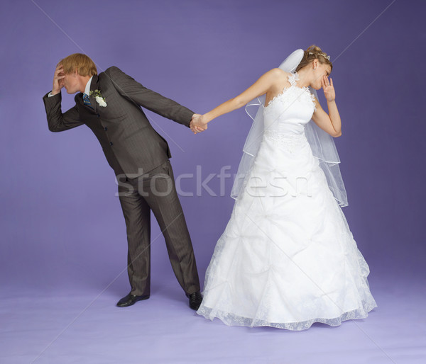 Comical emotional groom and bride holding hands Stock photo © pzaxe