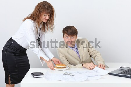 Woman has got tired and falls asleep on a workplace Stock photo © pzaxe