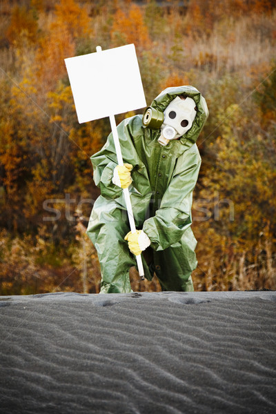 Scientist in gas mask with poster Stock photo © pzaxe