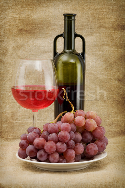 Green bottle, goblet and grapes Stock photo © pzaxe