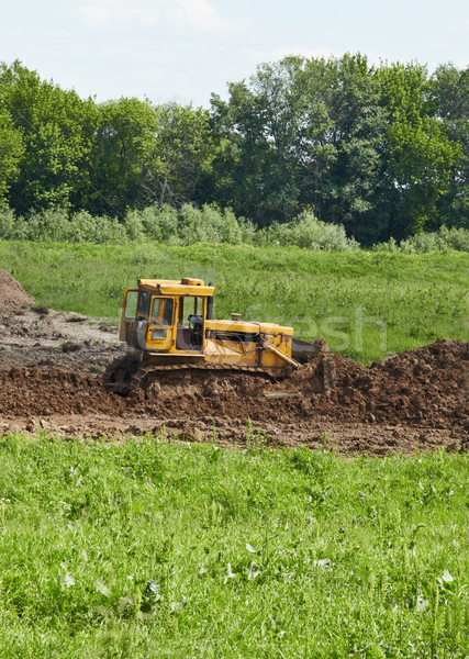 Old caterpillar tractor works in fields Stock photo © pzaxe