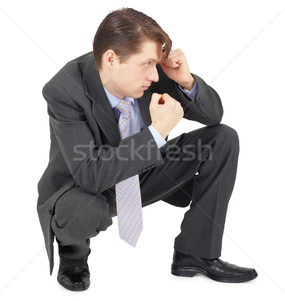 Businessman sitting in defensive pose Stock photo © pzaxe