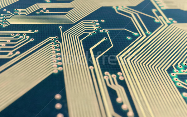Green computer plate with golden paths Stock photo © pzaxe