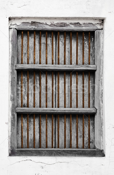 Old wooden window with rusty grate Stock photo © pzaxe