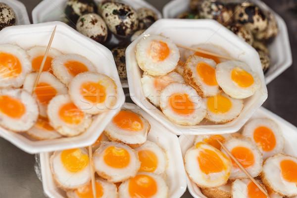 Scrambled quail eggs and boiled eggs at market Stock photo © pzaxe