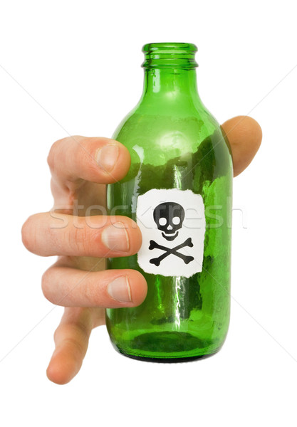 Male hand with green bottle pictured skull and crossbones Stock photo © pzaxe