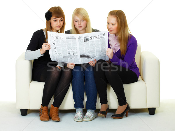 Young girl reading newspaper Stock photo © pzaxe
