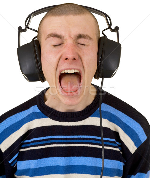 Young man in earphones loudly sings Stock photo © pzaxe