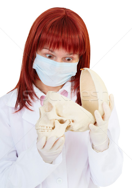 Young woman in amazement looking at skull Stock photo © pzaxe