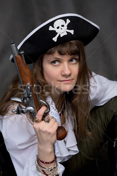 Lány kalóz pisztoly kéz fekete nő Stock fotó © pzaxe