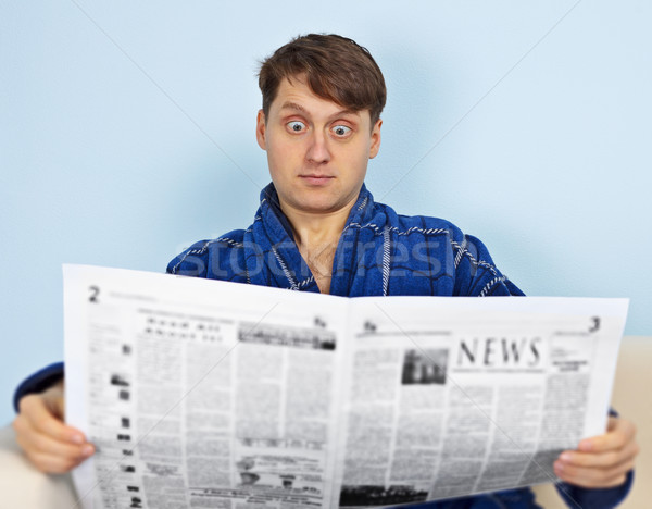 Man reads a newspaper with a admiration Stock photo © pzaxe