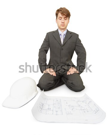 Serious engineer ponders bent over drawings Stock photo © pzaxe