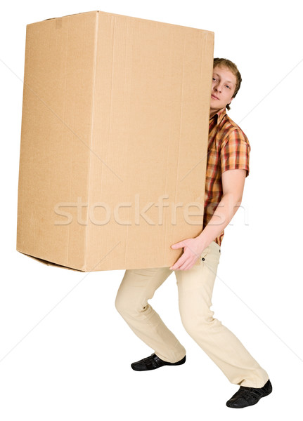 Stock photo: Man bears the big heavy cardboard box