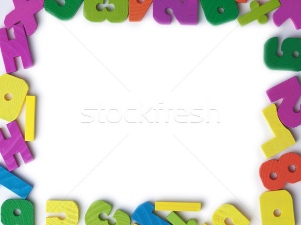 Blank frame of colored wooden toy figures Stock photo © pzaxe