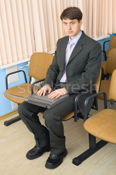 Person in a suit with the laptop Stock photo © pzaxe