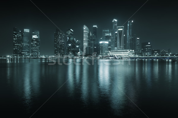 Singapore skyline at night - skyscrapers with reflections. Stock photo © pzaxe