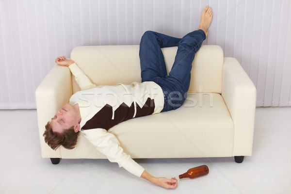 Drunk person funny sleeps on sofa Stock photo © pzaxe
