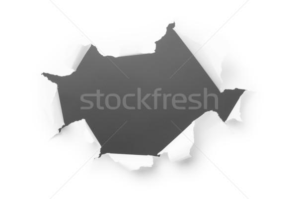 Dark hole in white paper Stock photo © pzaxe