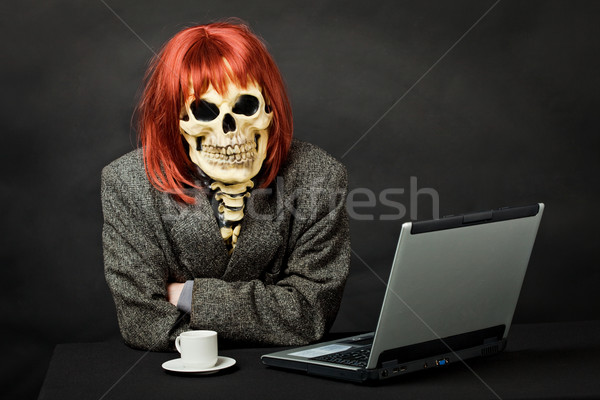 Man dressed as death sits at table with computer Stock photo © pzaxe