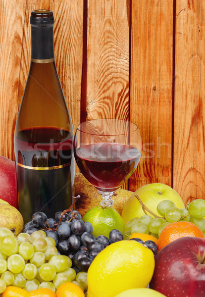 Wine and fruits on background of wooden wall Stock photo © pzaxe