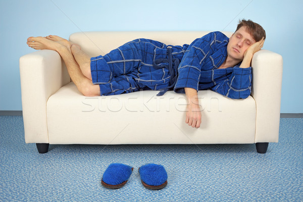 Man is resting at home after work Stock photo © pzaxe
