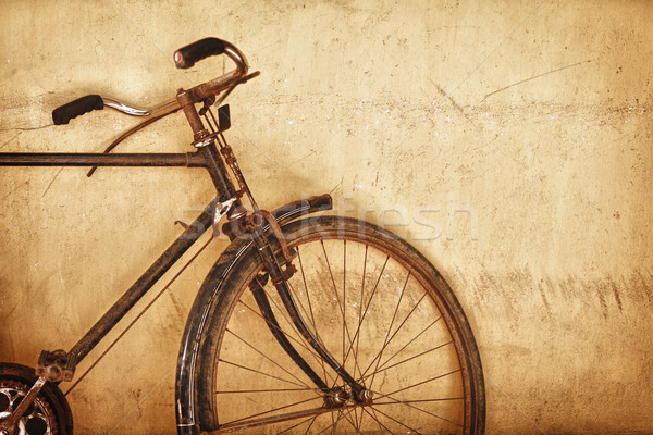 Old-fashioned rusty bicycle near the wall Stock photo © pzaxe