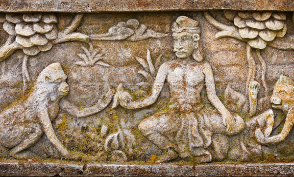 Old bas-relief on the wall of the temple. Indonesia, Bali Stock photo © pzaxe