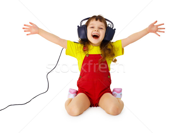 Happy girl listens to music with headphones Stock photo © pzaxe